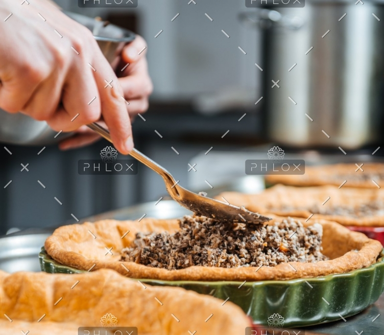 hands-of-cheif-cook-cooking-and-putting-filling-PESKNNF
