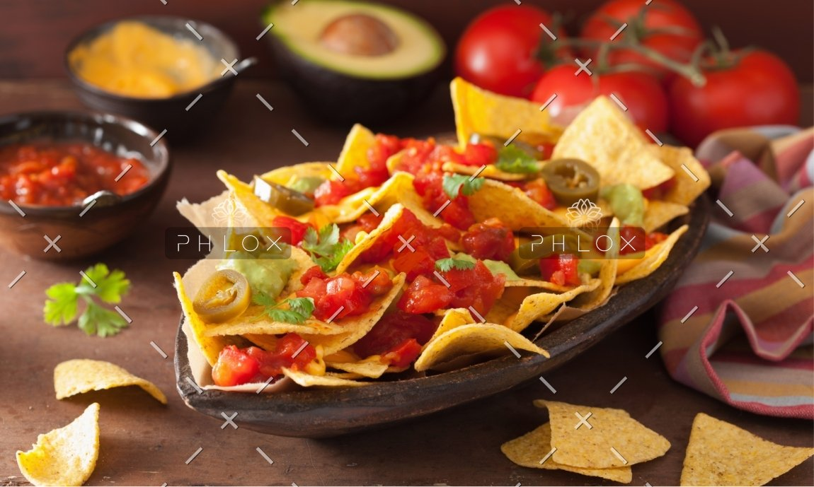 nachos-loaded-with-salsa-guacamole-cheese-and-P7GUFN7